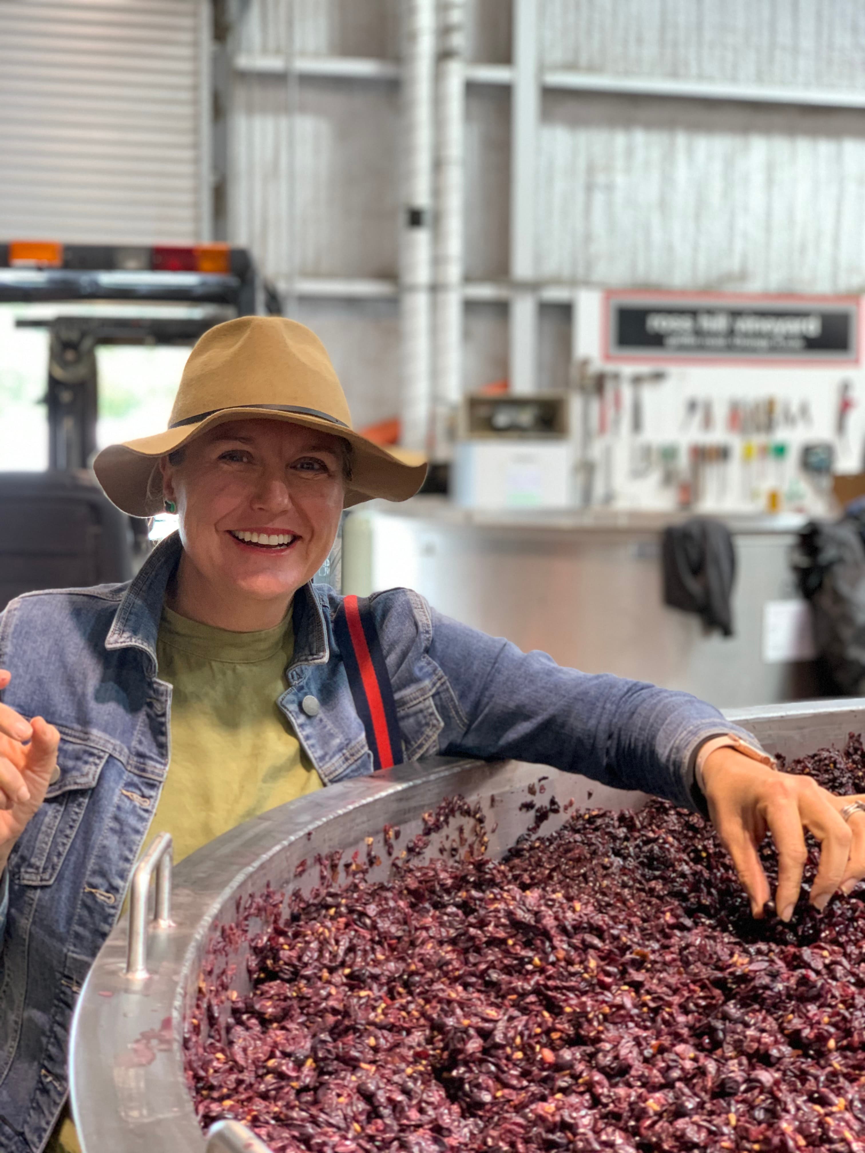 lady with grapes in fermentation