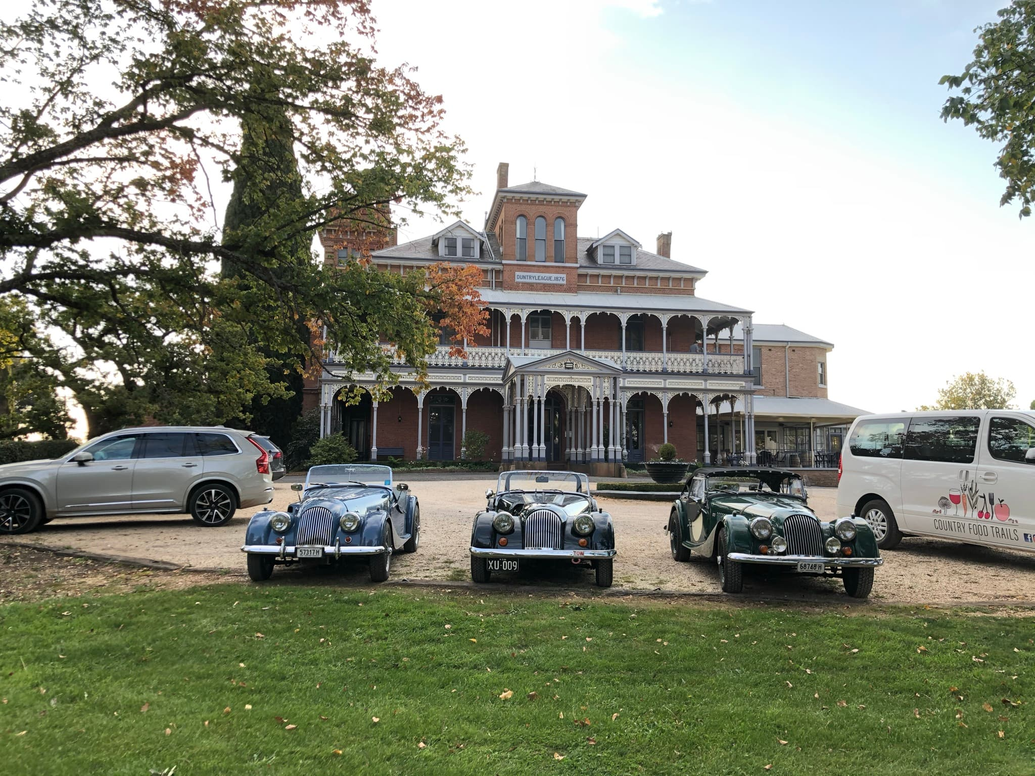 3 vintage cars out the front of the historic mansion of Duntryleague