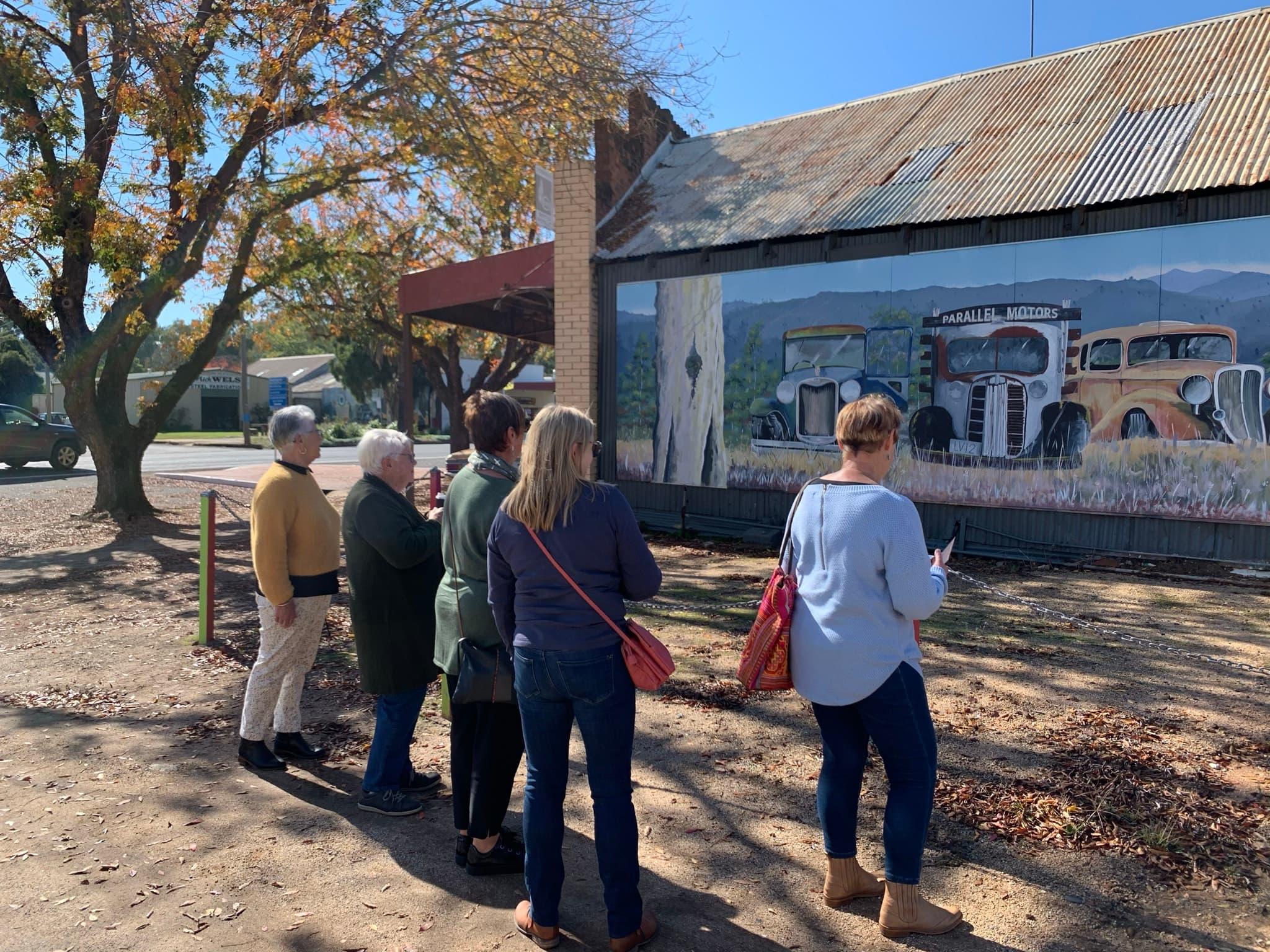 5 ladies looking at mural of old cars in Eugowra