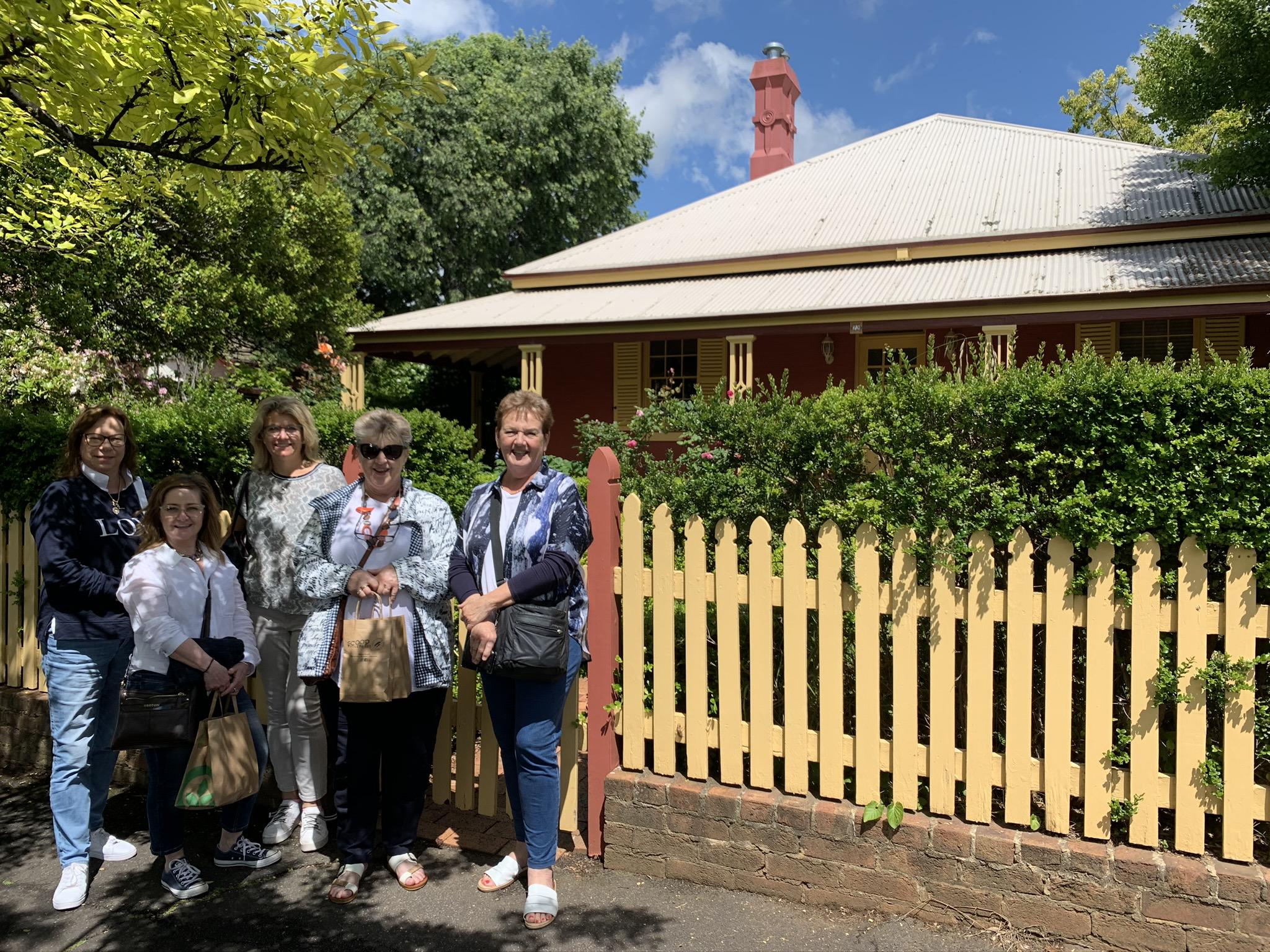5 ladies standing in front of heritage building