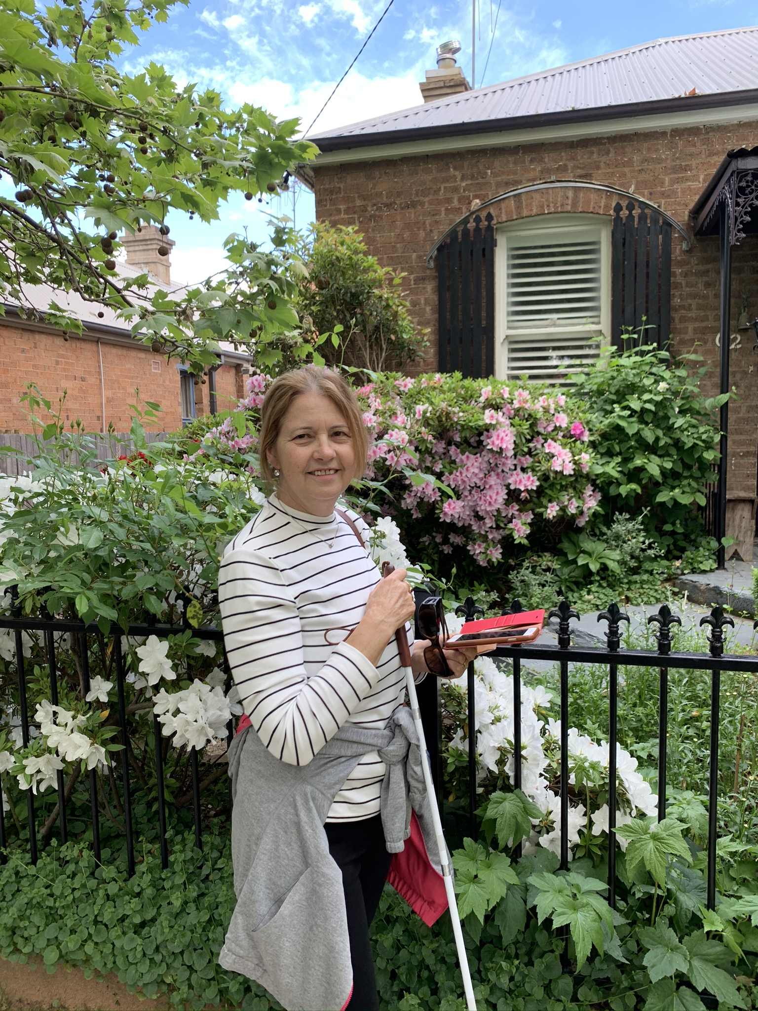 visually impaired lady in front of garden