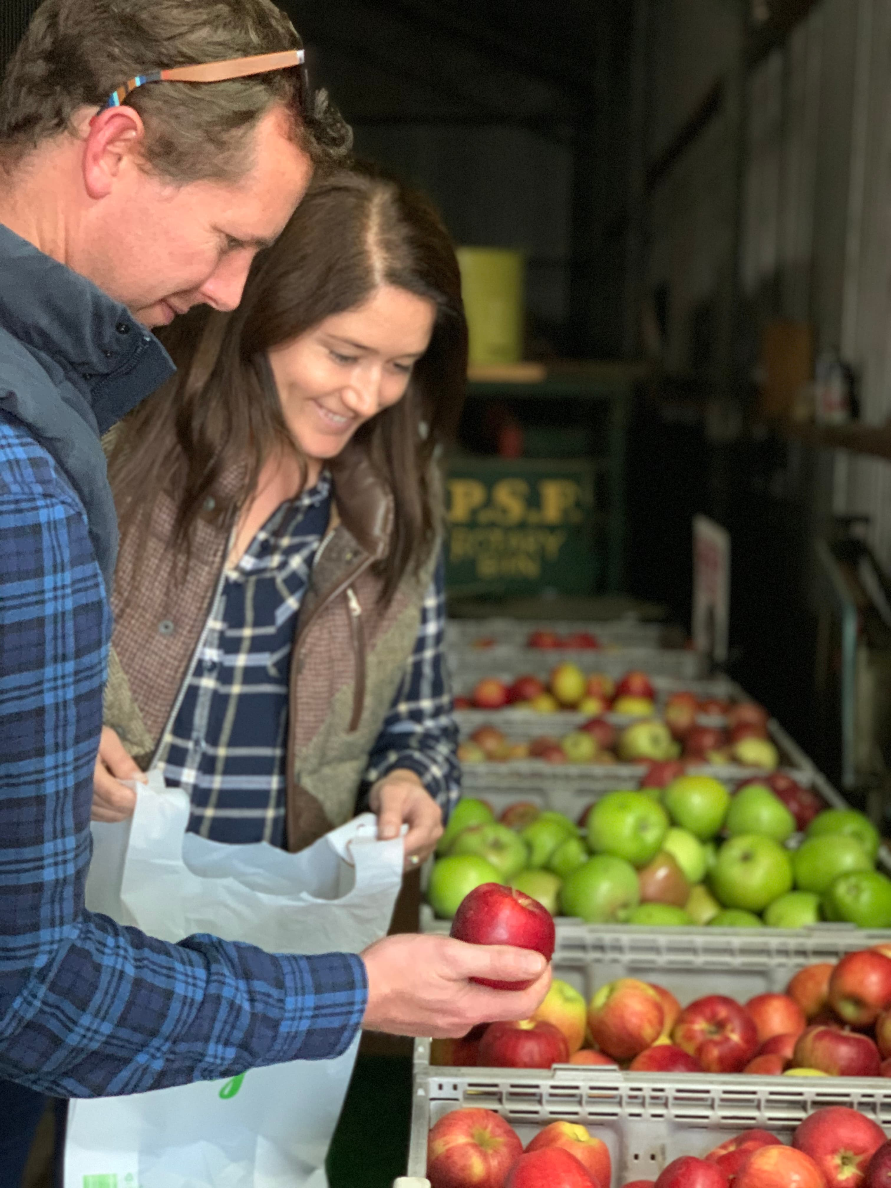 Young couple selecting apples