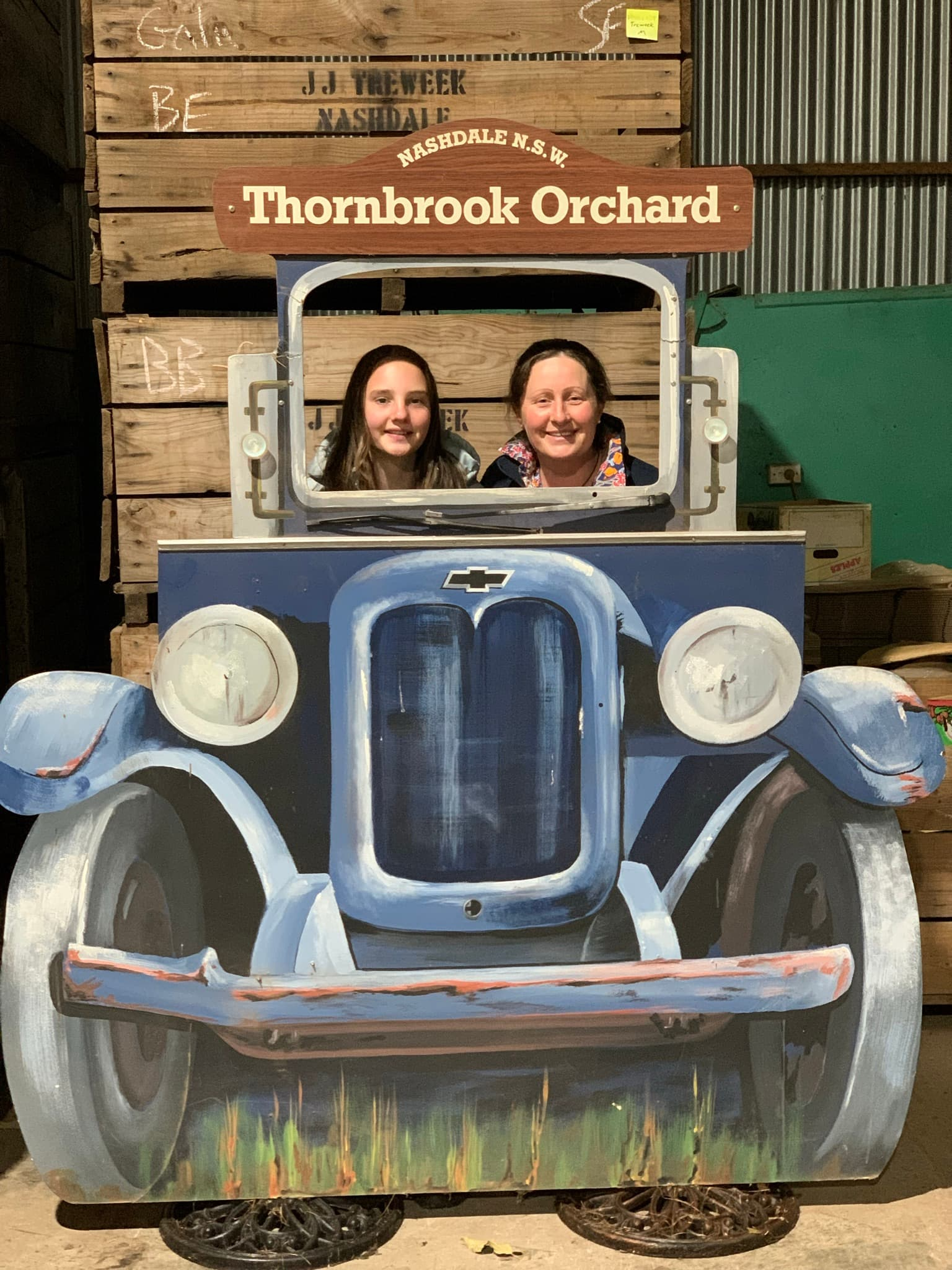 mother and daughter in car frame photo booth