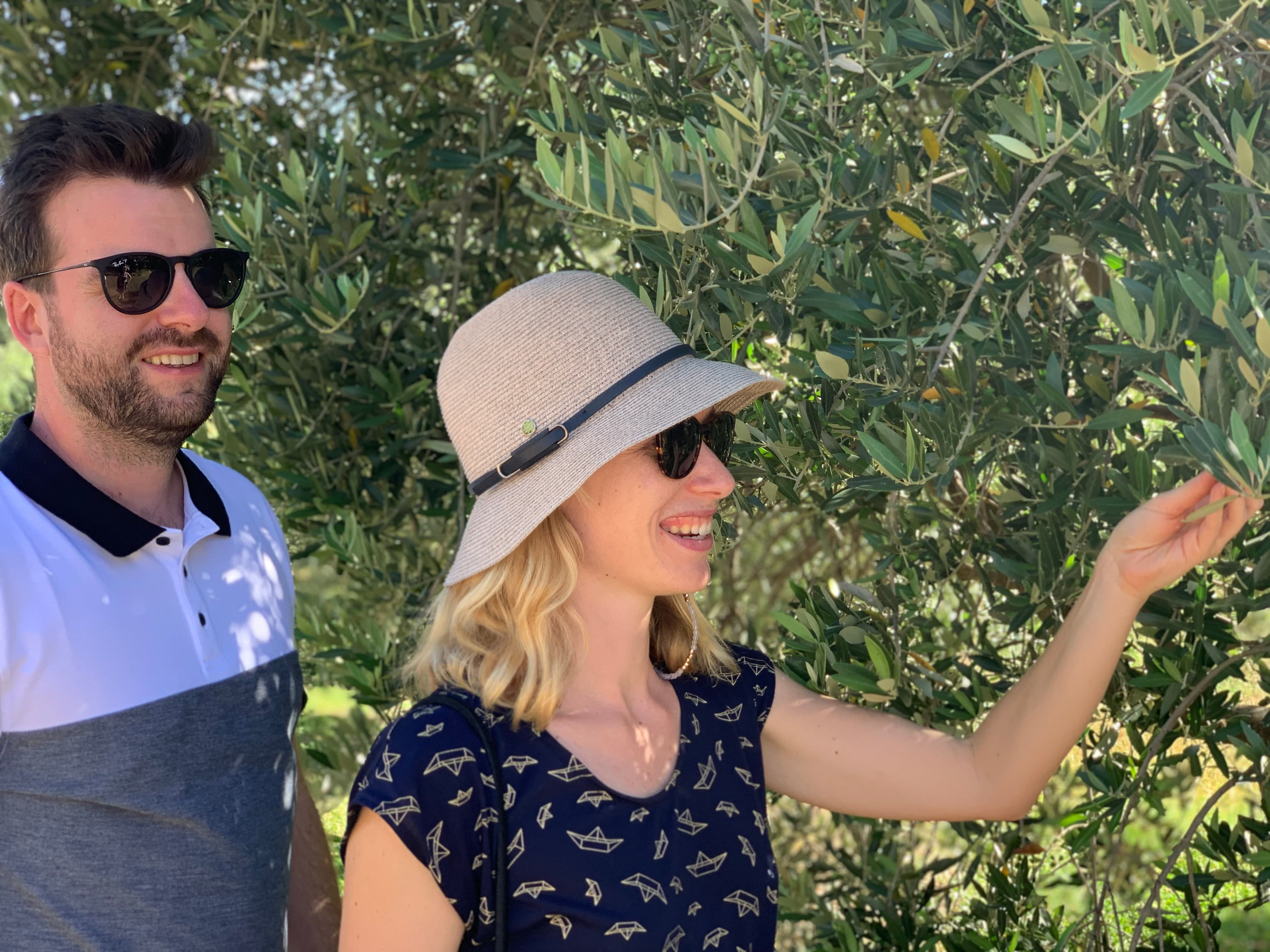 young couple looking at fruit tree