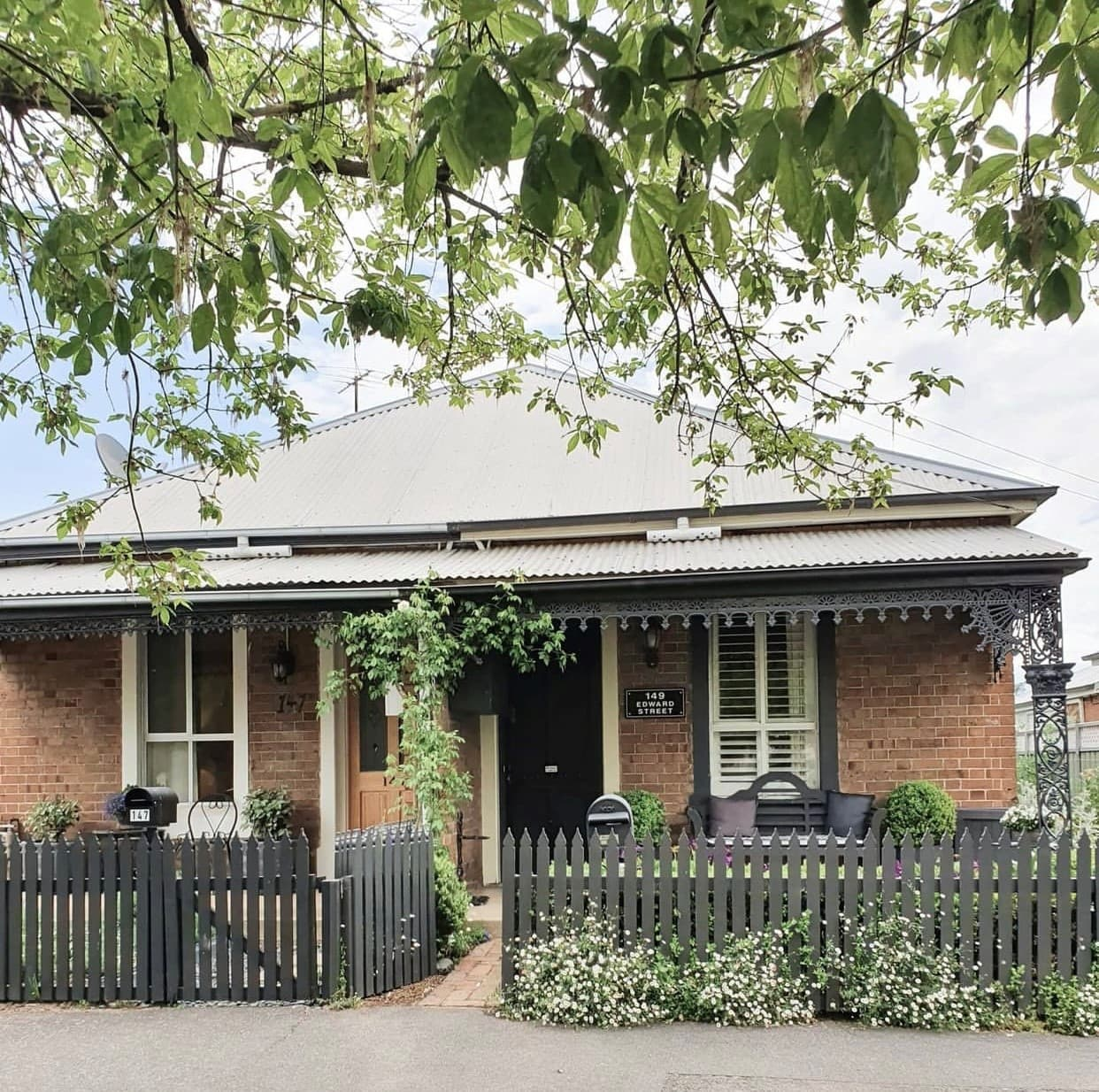 heritage cottage with picket fence