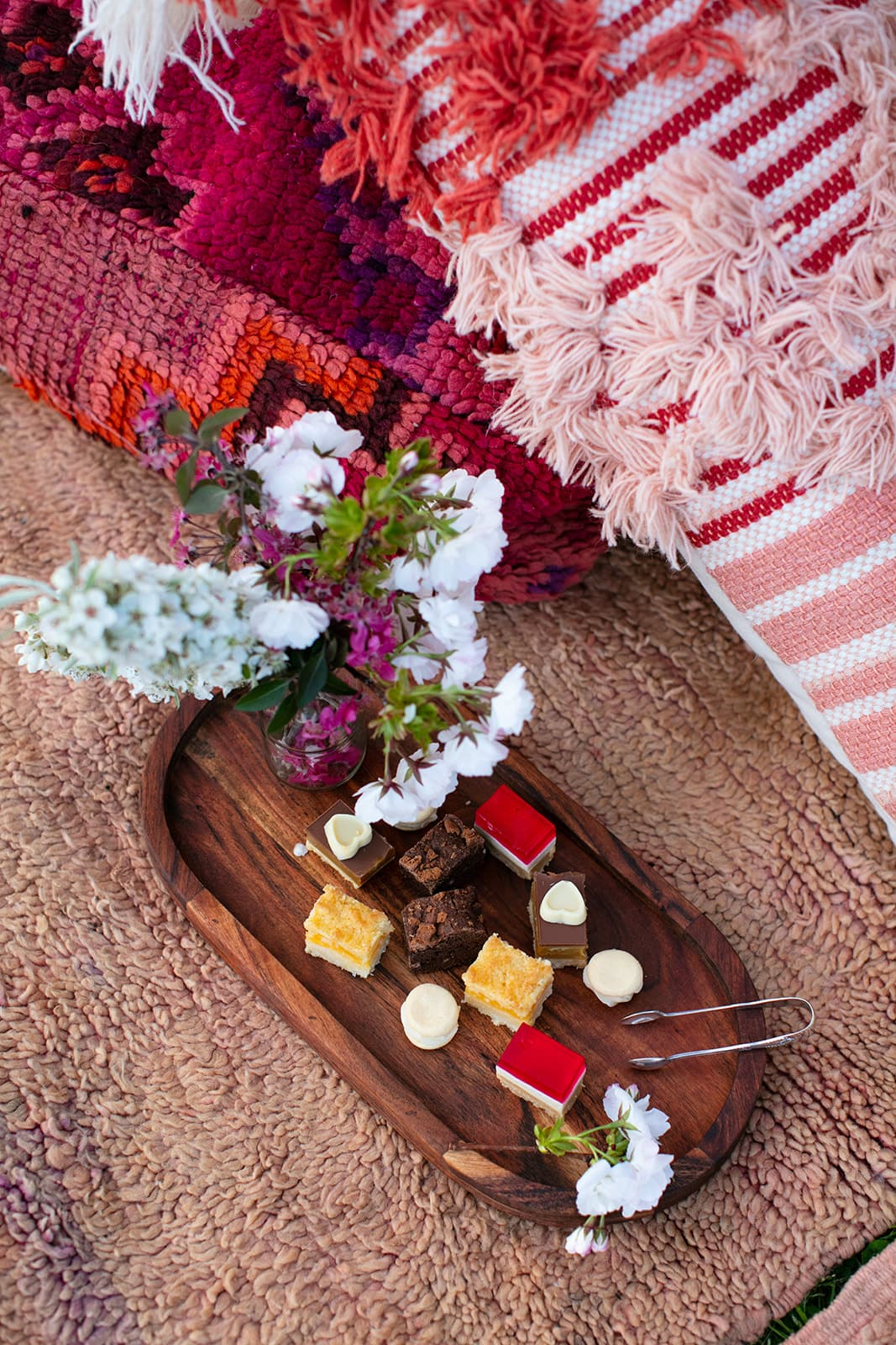 picnic rug with tray of sweets