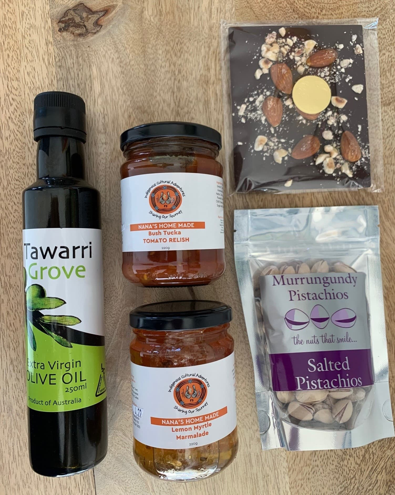 hamper of Orange produce including nuts, oilve oil, relish and chocolate